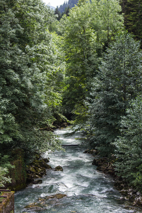 The strength of a mountain river stock photos