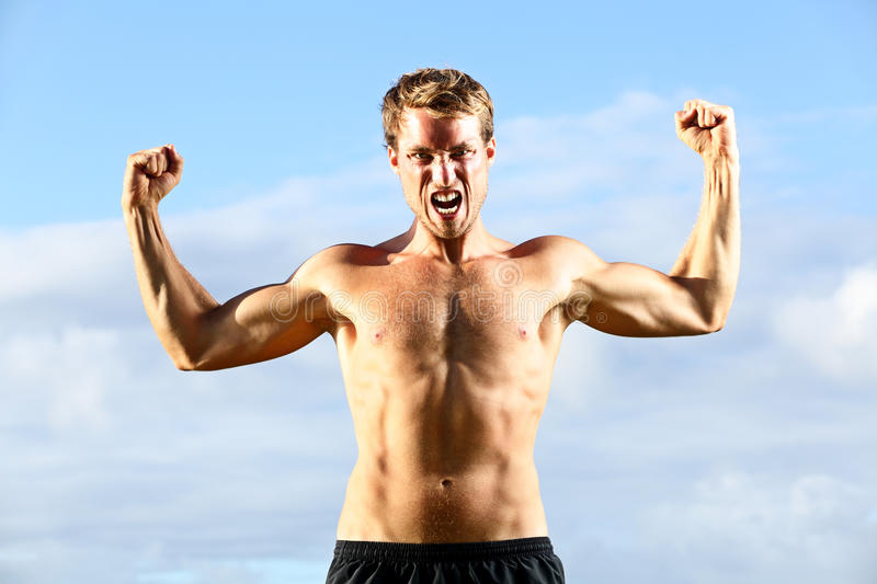 Strength - strong aggressive fitness man flexing royalty free stock images