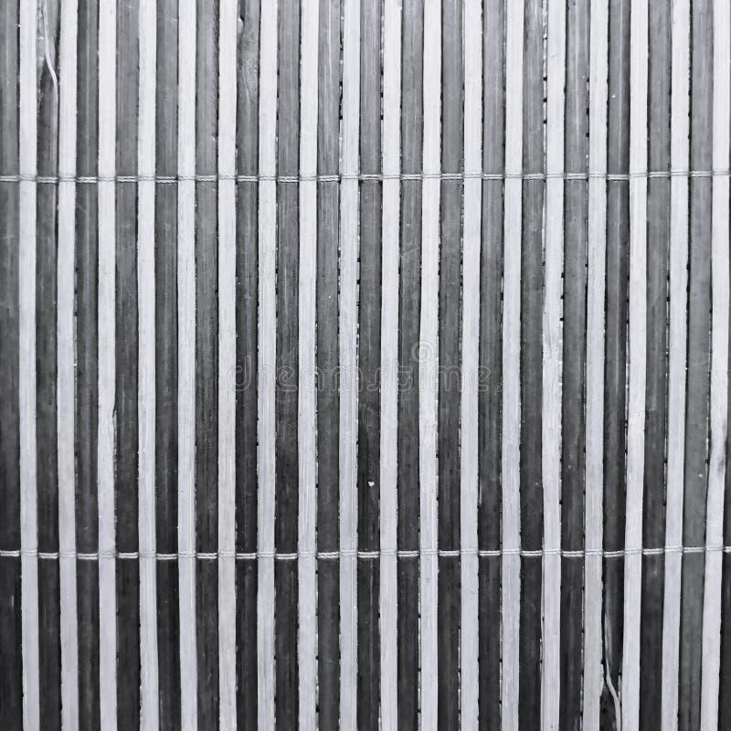 Strepentextuur van een bamboemat stock fotografie