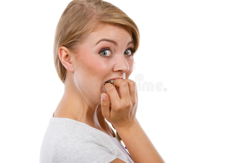 Scared, stressed woman biting her nails stock photos