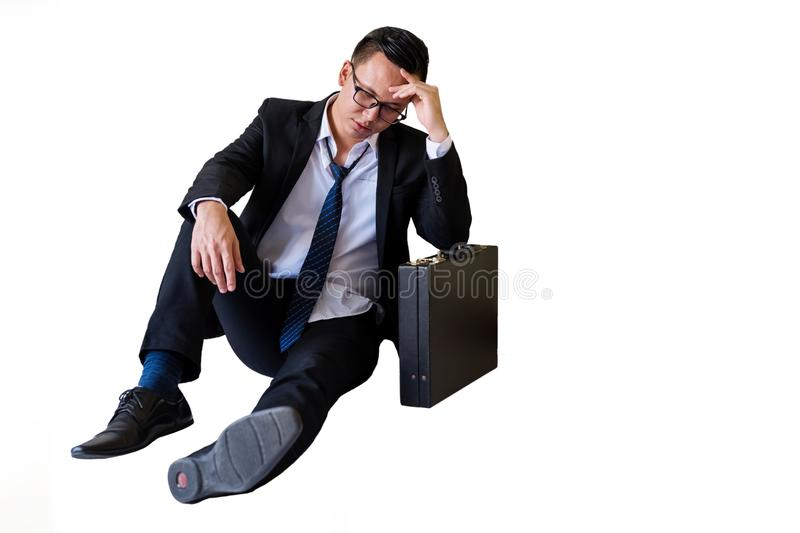 Stress Asian businessman isolated on white. Stress young Asian businessman with glasses sit isolated on white background with copy space for text. Feeling sad royalty free stock images