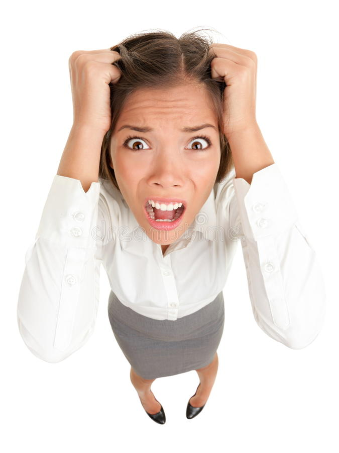 Stress business woman. Stress. Business woman frustrated and stressed pulling her hair. Funny image of young Caucasian Asian businesswoman