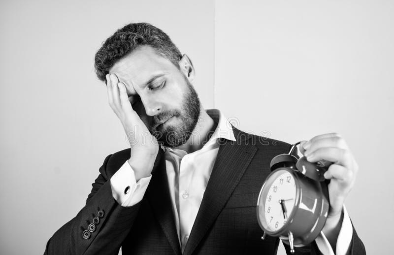Stress concept. Mature man beard tired because of work. Businessman has lack of time. Time management skills. How much. Time left till deadline. Time to work royalty free stock image