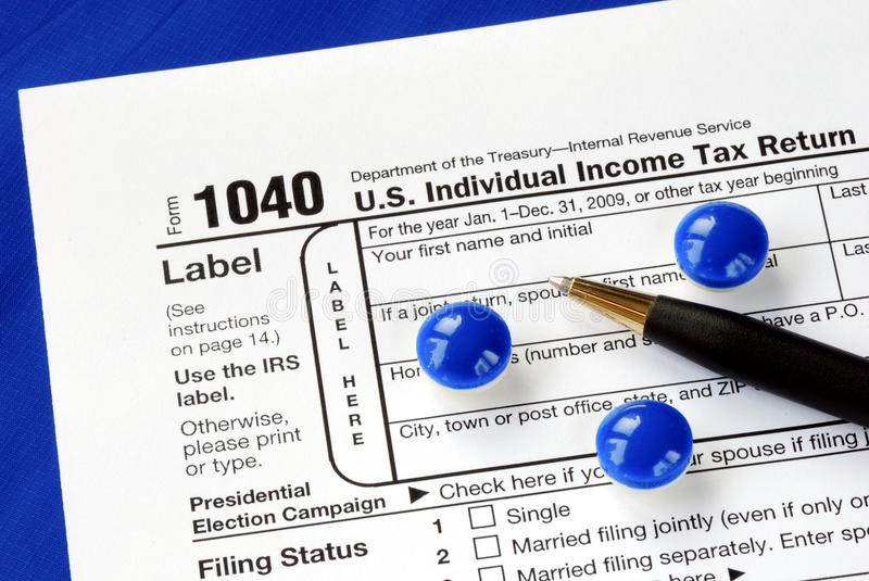 Download Stress And Headache In Filing The Tax Return Stock Photo - Image: 12505030