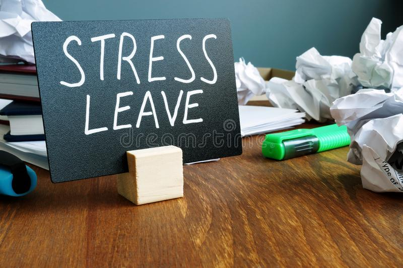 Stress leave. Office desk with paper balls royalty free stock photos