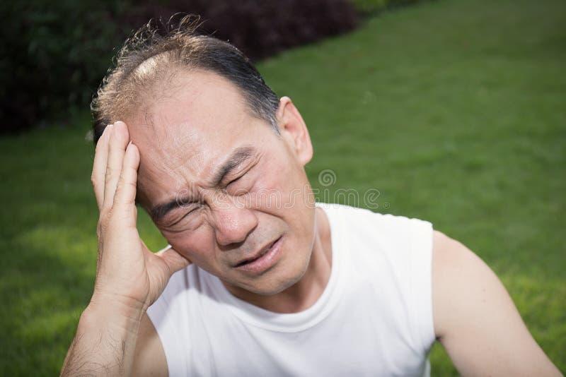 Stress Man holding his head stock photo