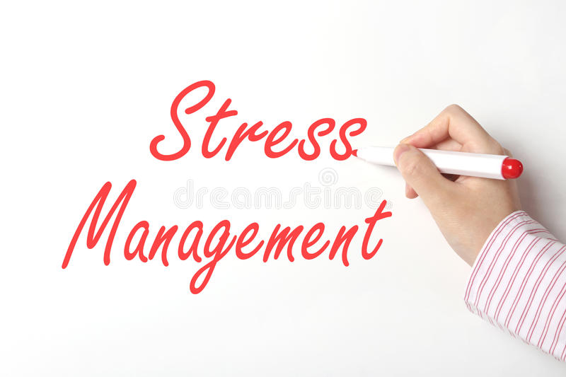 Stress management concept. Business woman writing stress management word on whiteboard stock images