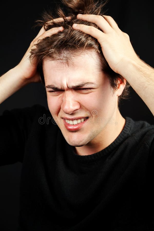 Stress mental pressure concept. Unhappy young man royalty free stock photos