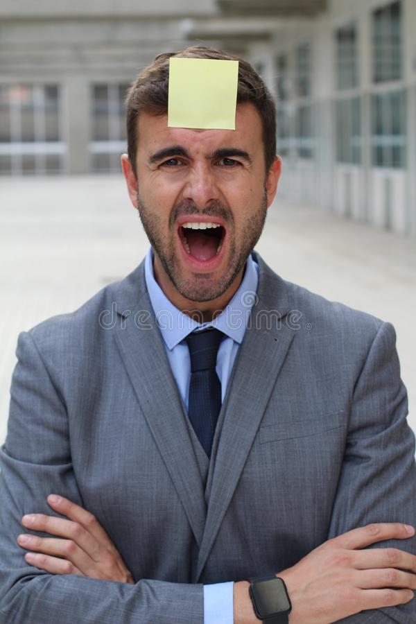 Stress out businessman with a note on his forehead stock photo