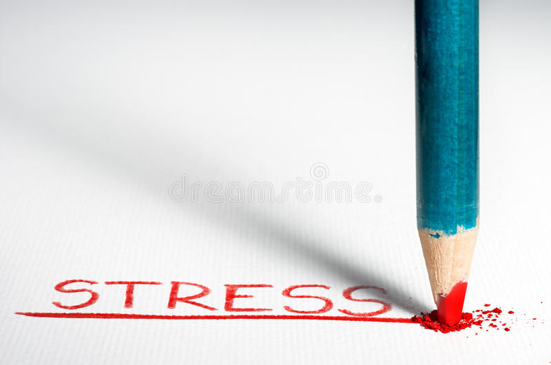 Stress. Pastel penci is being smashed on the paper with great force after writing the word 'Stress royalty free stock images