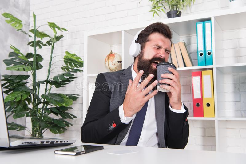 Stress resistance concept. Manager relaxing with favorite music and cup of coffee. Successful businessman. Man office stock images