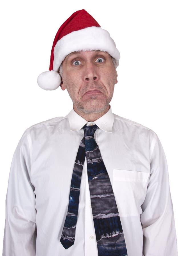 Stress, Sad Businessman Christmas Santa Hat royalty free stock image