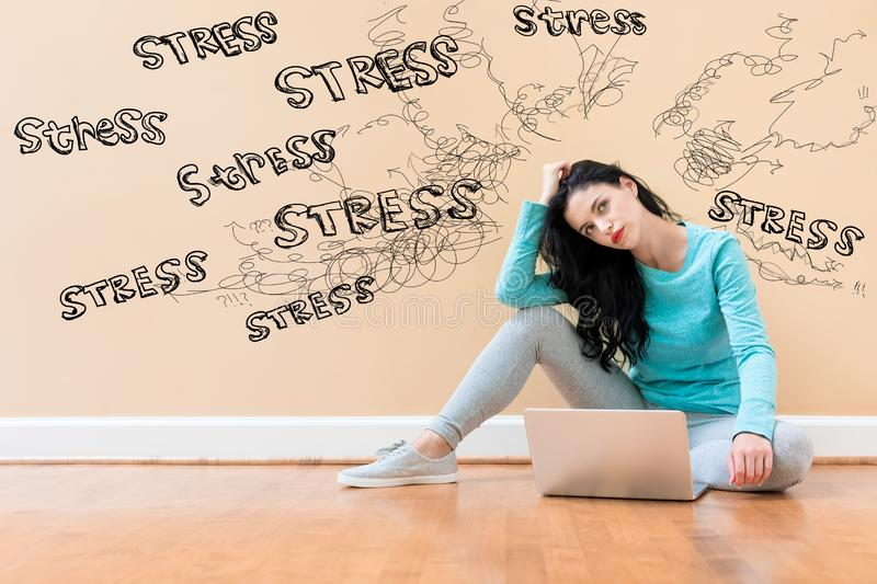 Stress theme with woman using a laptop royalty free stock photography