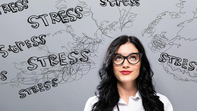 Stress theme with young businesswoman. In a thoughtful face royalty free stock images