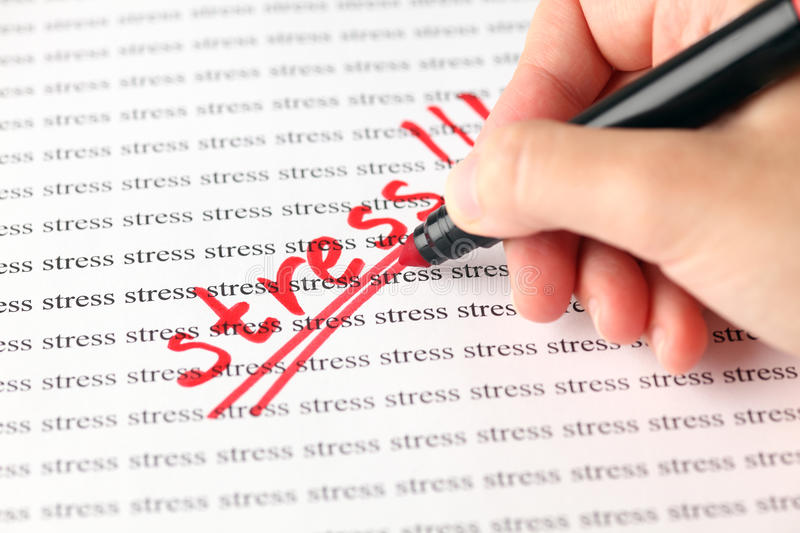Stress !!!. Woman's hand with red pen writing word stress stock photography