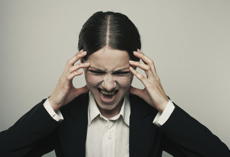 Stress woman stressed is going crazy pulling her hair in frustration close up of young businesswoman stock photo