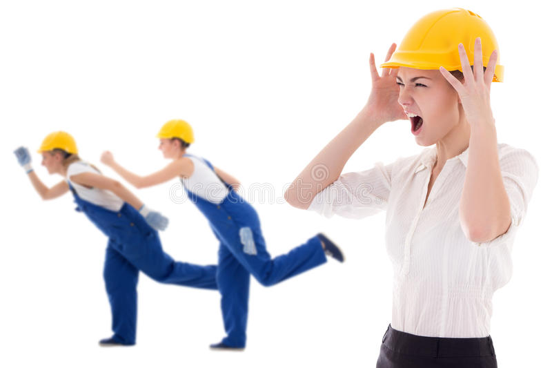 Stress at work -business woman architect in yellow builder helmet shouting on workers isolated on white. Stress at work -business women architect in yellow stock photography