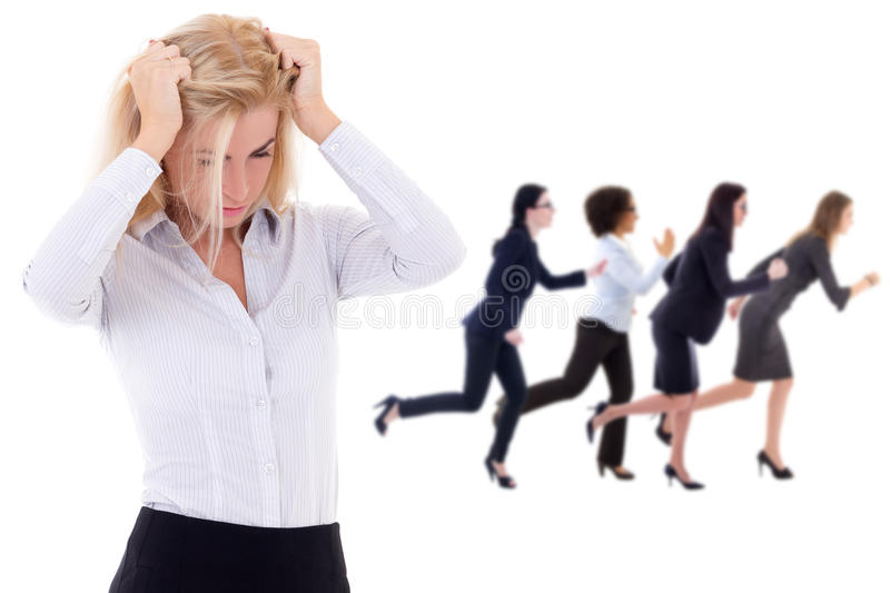 Stress at work - stressed business woman and her running colleagues isolated on white. Stress at work - stressed business women and her running colleagues stock photos