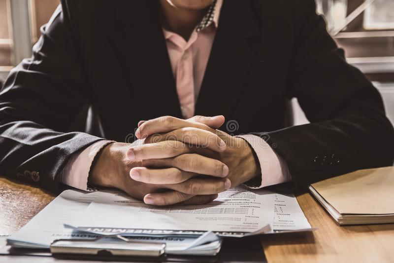 Stress worry probleme.businessman sitting office working contract papers on wood table. of advisor Concepts and vintage, Sunset stock image