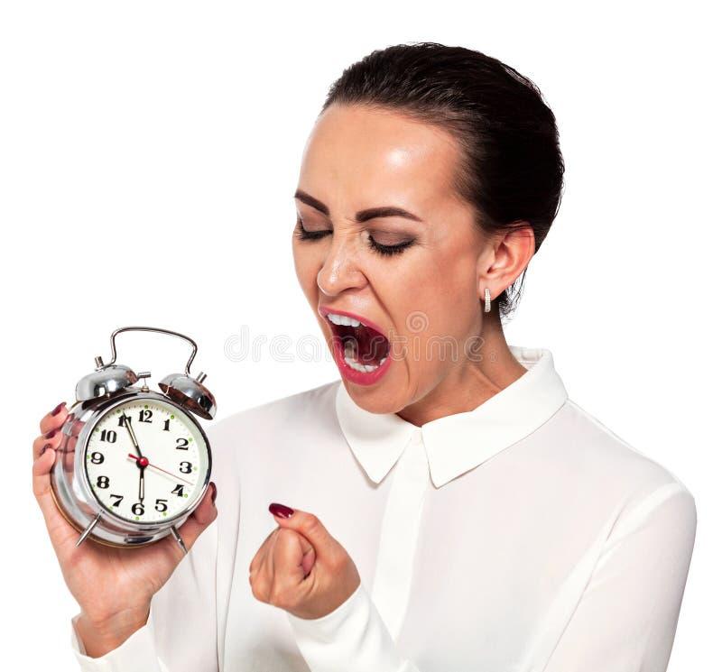 Stressad affärskvinna med en ringklocka royaltyfri foto