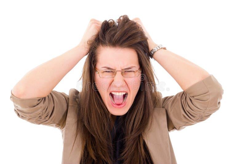 Stressad kvinna som drar hennes hår i frustration royaltyfria foton