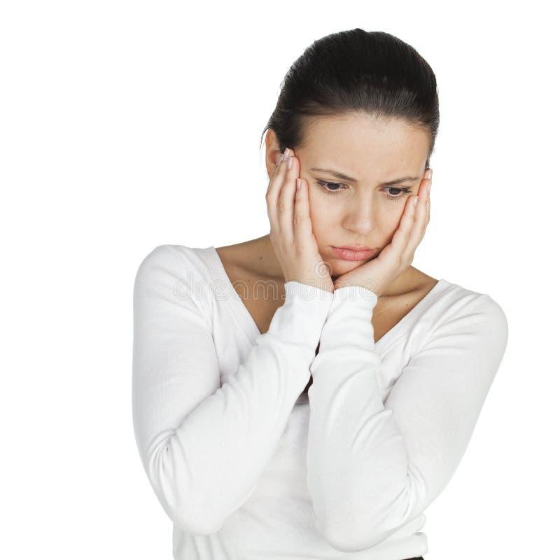 Stressad och deprimerad ung atractive brunettkvinna som isoleras royaltyfria foton