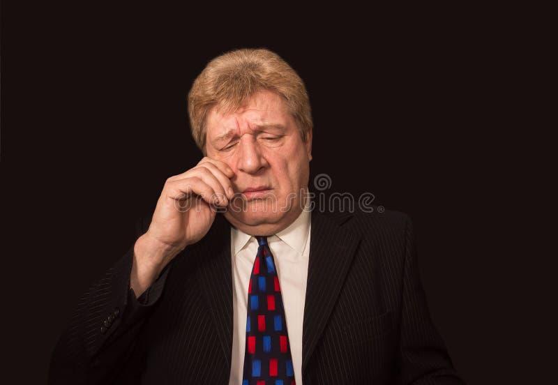 Stressade höga caucasian affärsmangnuggbildögon arkivbild