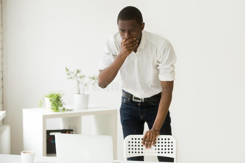 Stressed African American shocked by negative business results stock photos