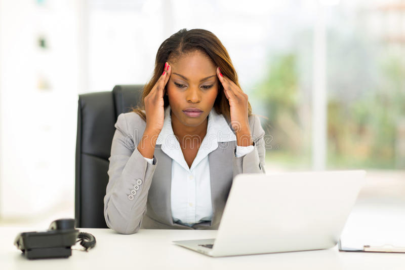 Stressed african businesswoman royalty free stock photo