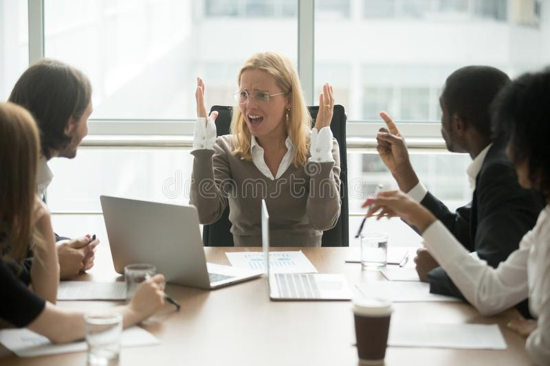 Stressed angry businesswoman arguing at meeting with male collea. Stressed angry businesswoman arguing at meeting with diverse male colleagues, women boss team royalty free stock photo