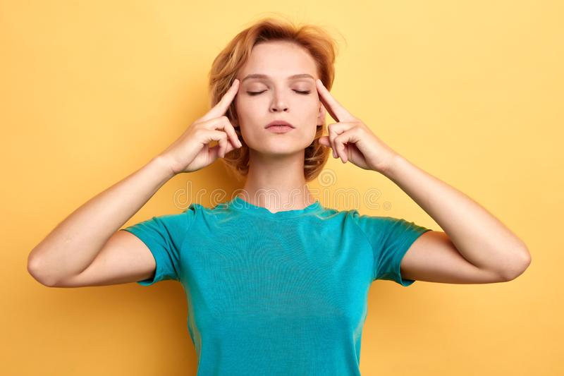 Stressed beautiful woman with closed eyes concentrated on her thoughts stock photos