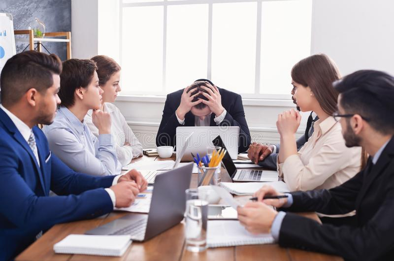 Stressed boss having problem at business meeting stock images