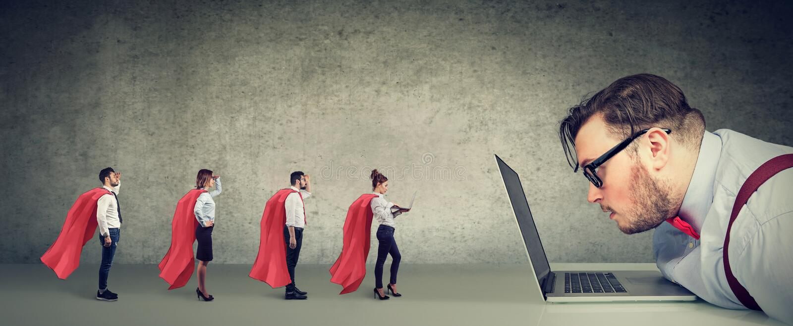 Stressed business man being helped online by professional team of super hero people royalty free stock image