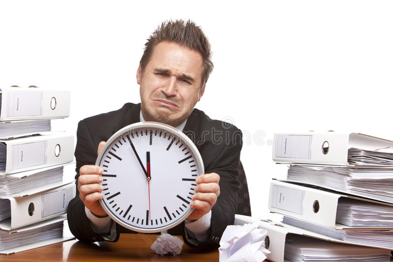 Stressed business man cries in office stock photo