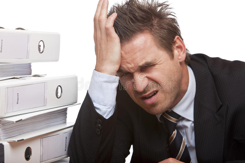 Stressed business man has bad headache in office stock photography