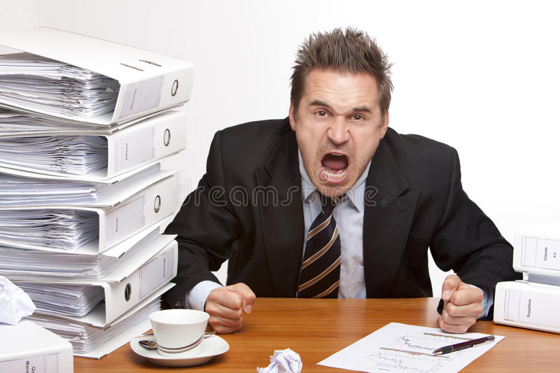 Stressed business man screams frustrated in office royalty free stock photography