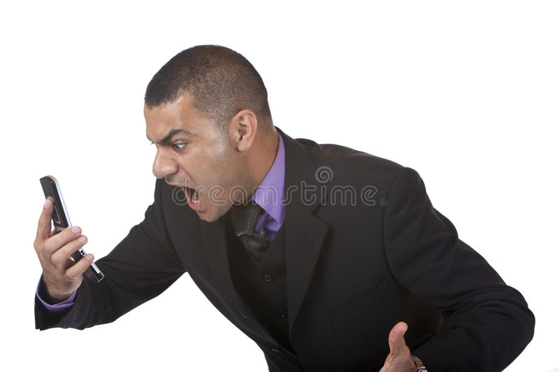 Stressed business man screams in telephone royalty free stock photo