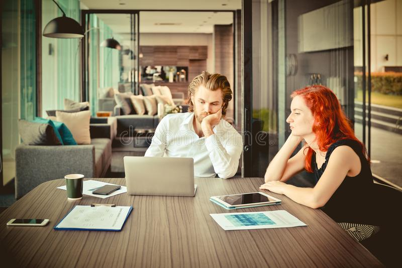 Stressed business people meeting in a meeting room, western busi stock images