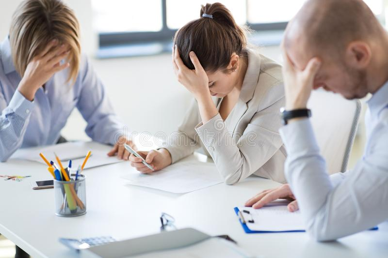 Stressed business team with papers at office stock photos