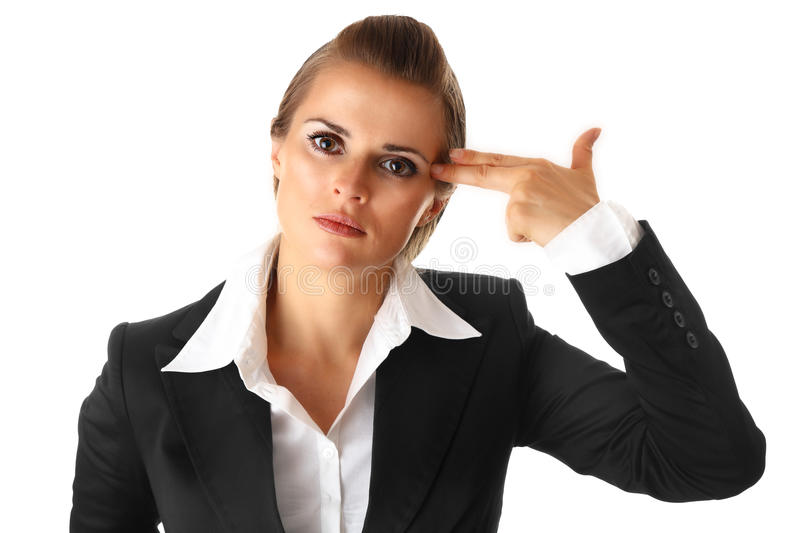 Stressed business woman with gun shaped hand royalty free stock photography