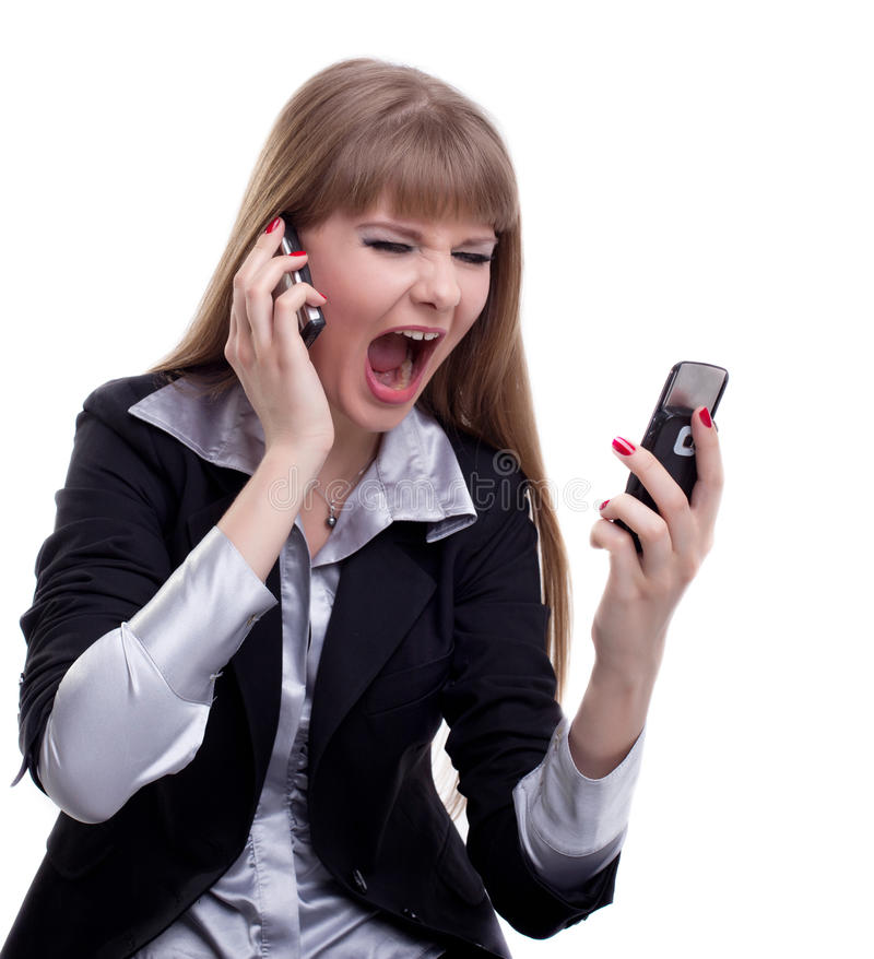 Stressed business woman with two cell phones. Portrait of stressed business woman with two mobile phones. Isolated on white stock photo