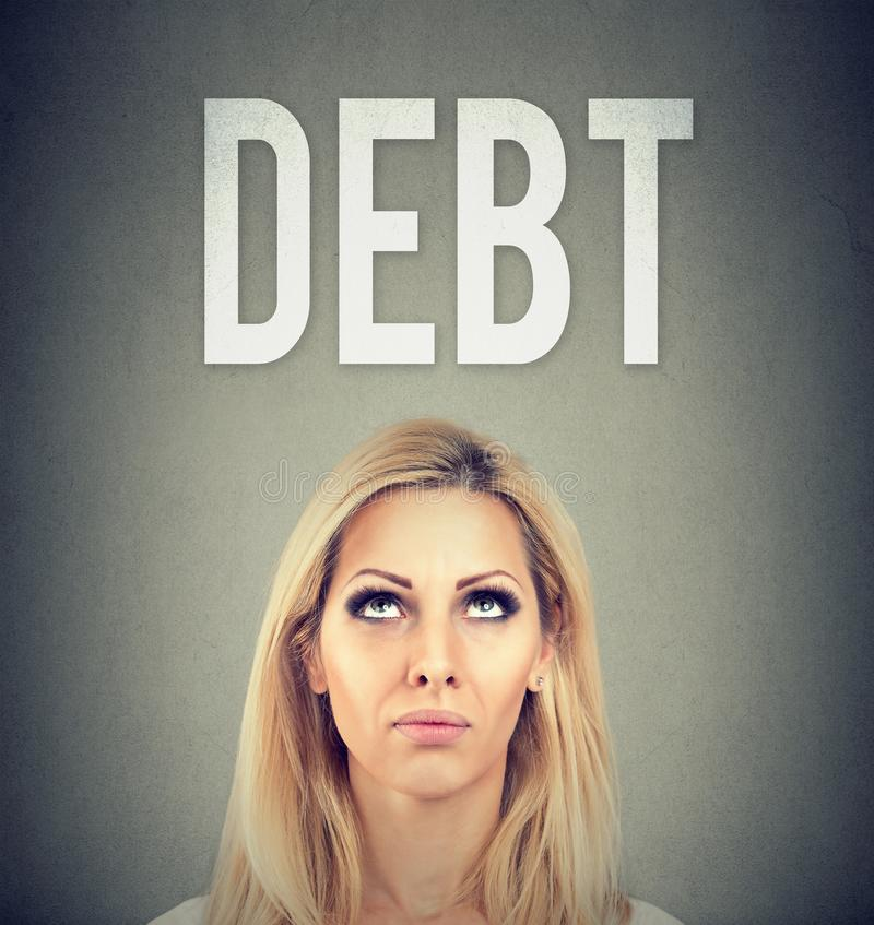 Stressed young business woman under debt pressure stock image