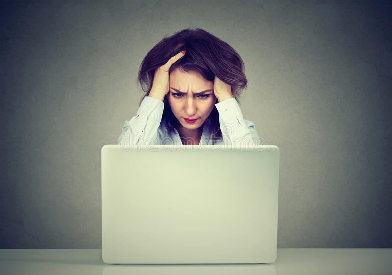Stressed business woman using a laptop stock photos