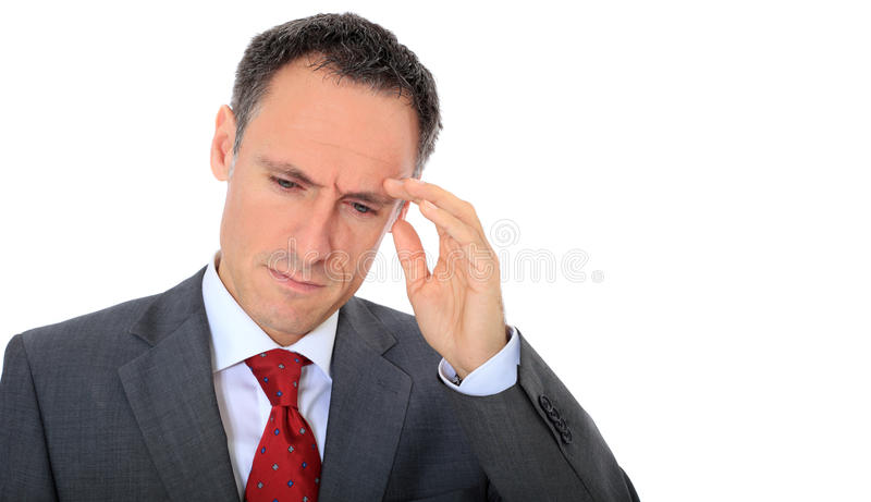 Stressed businessman. Middle-aged businessman suffers from headache. All on white background royalty free stock photo