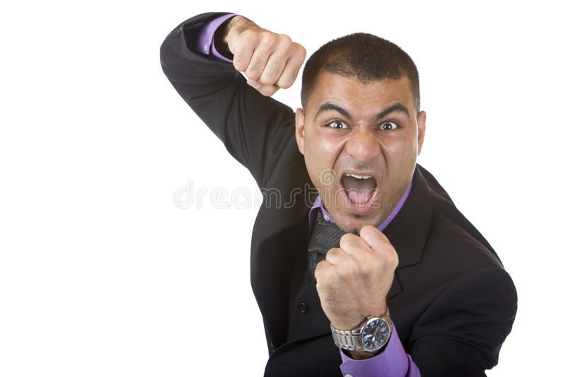 Stressed Businessman is angry and shows fists stock photography