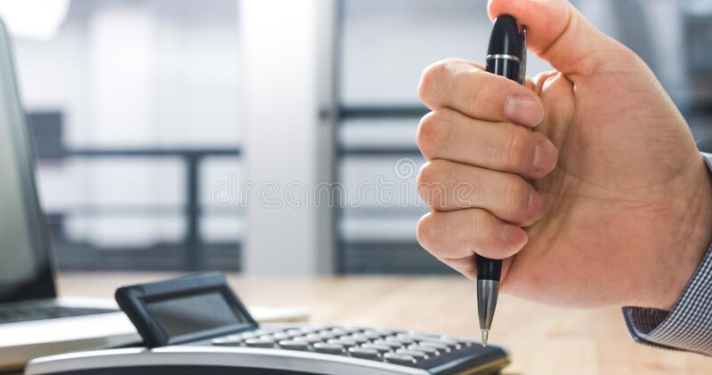 Stressed businessman clicking on pen. Under stress and nervous businessman clicking on pen. Anxious for Deadline at work stock photos
