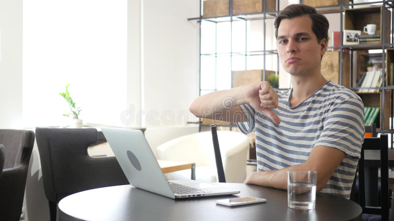 stressed businessman, designer in the office, Thumbs Down, Failure stock image