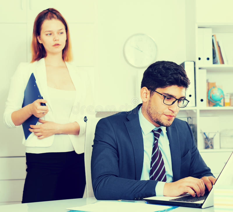 Stressed businessman with dissatisfied female colleague royalty free stock photography