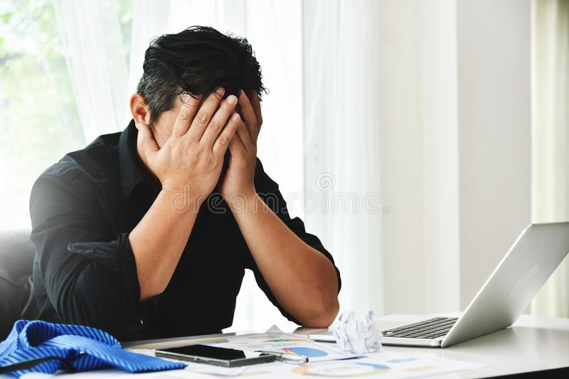 Stressed businessman is failing. stock photography
