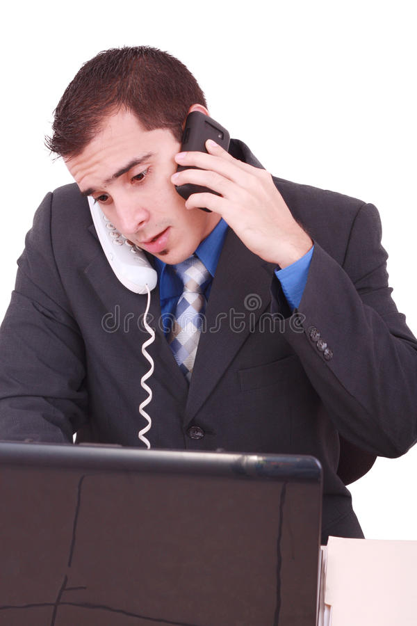Stressed Businessman At His Desk Working stock images